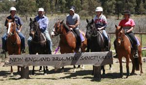 Craig Burton, centre, with his escort riders.